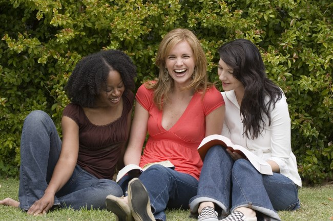 Diverse woman in a small group reading.