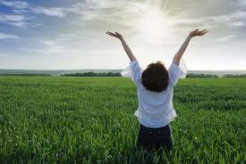 woman praising in field